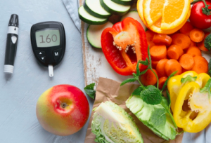 Blood sugar monitor next to fruit and vegetable